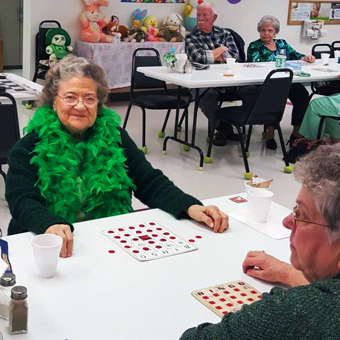 People playing bingo on St. Patricks day in fun costumes